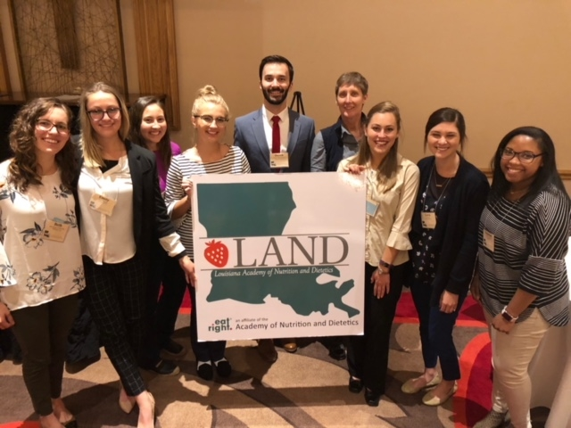Dietetic internship class of 10 peopel standing with sign